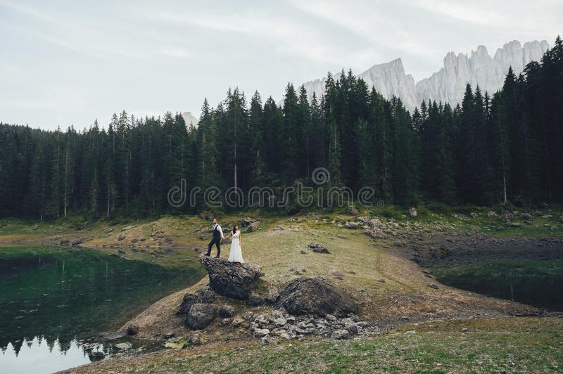 happy couple bride and groom holding hands in wedding day in Ita royalty free stock photos