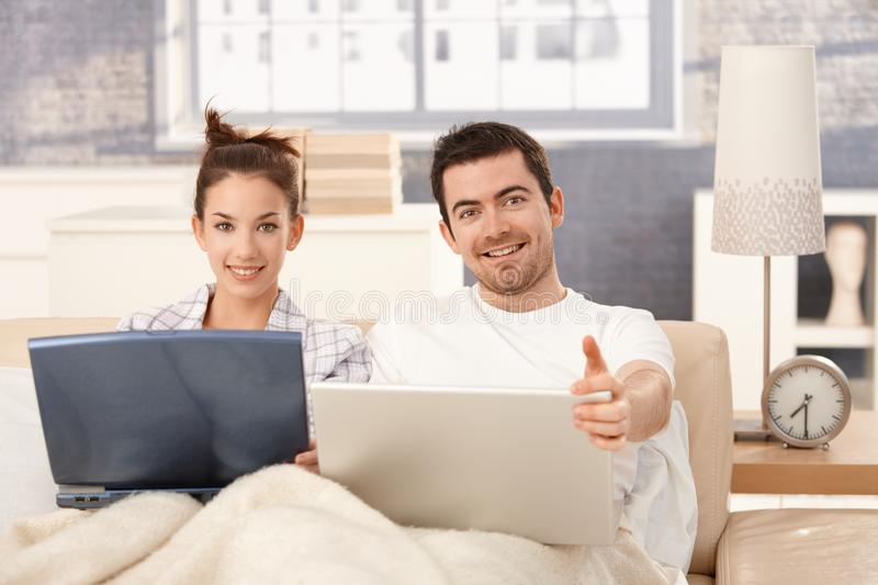 Download Happy Couple Browsing Internet In Bed At Home Stock Image - Image: 27995017