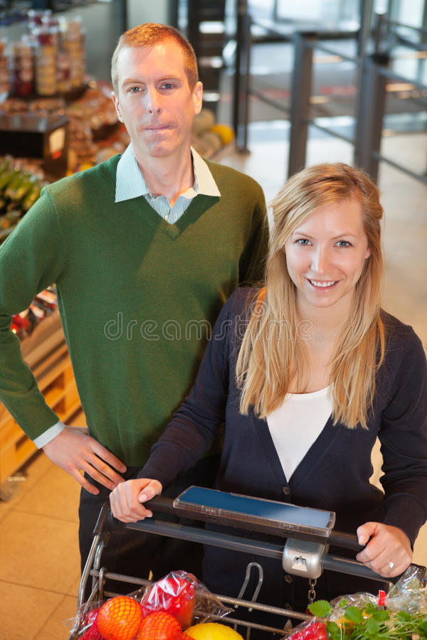 Download Happy Couple Buying Groceries Stock Photo - Image of department, buying: 19295596