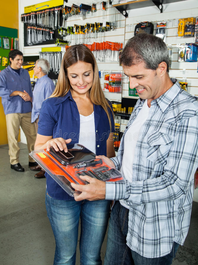 Happy Couple Buying Tool Set In Hardware Store stock photography