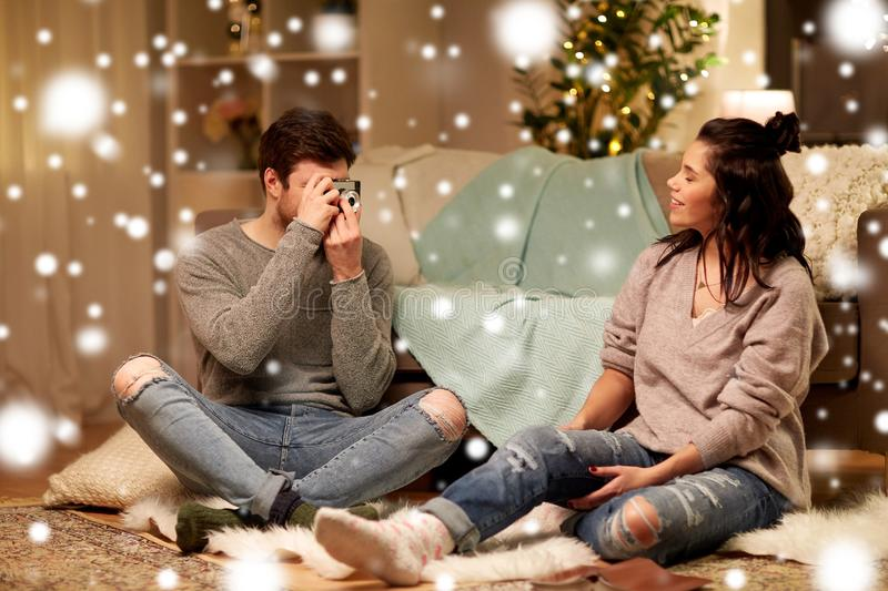 Happy couple with camera photographing at home royalty free stock photos