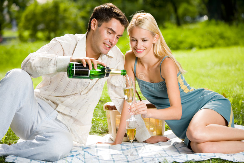 Happy couple celebrating royalty free stock photo