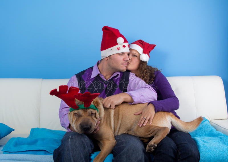 Happy couple celebrating christmas stock images