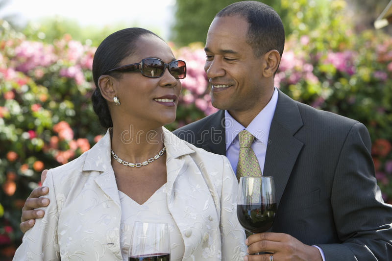 Happy Couple Celebrating With Wine stock image