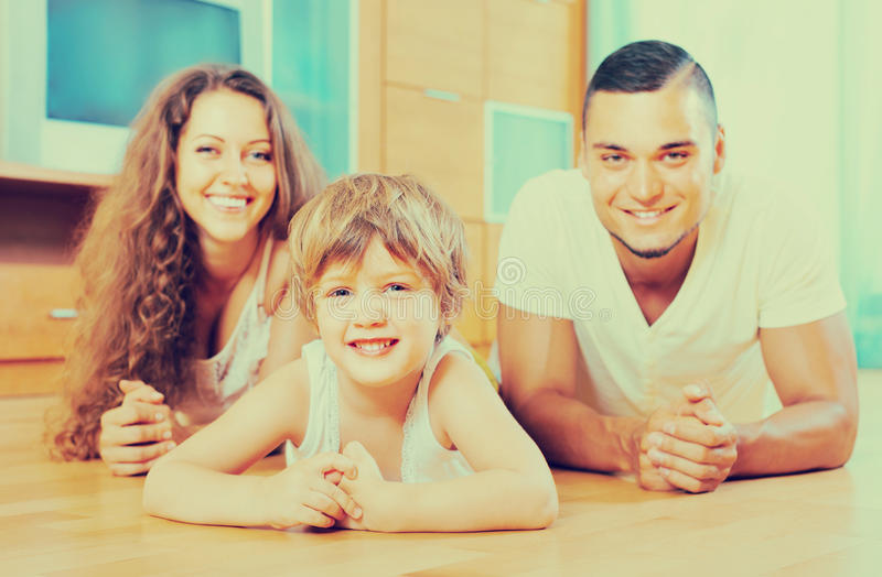 Happy couple with child at home royalty free stock photo