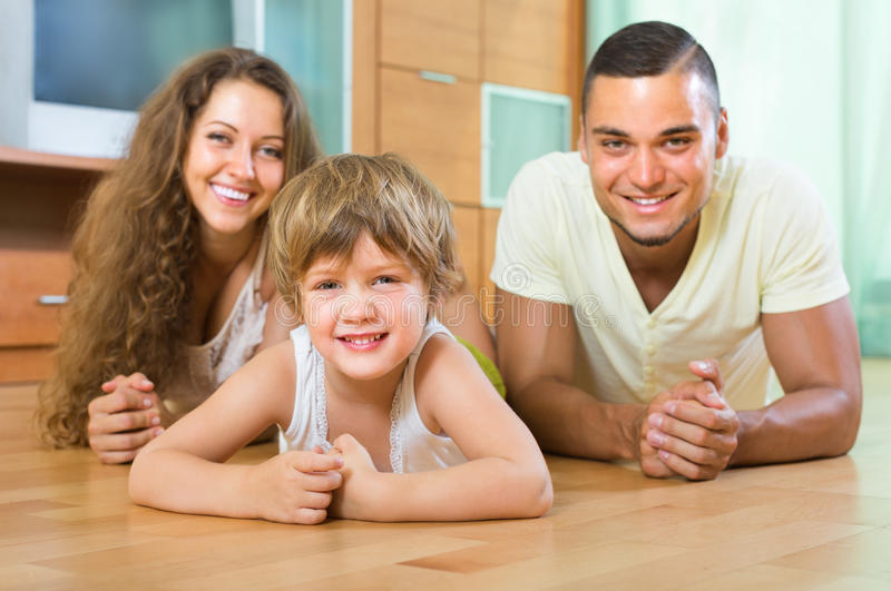 Happy couple with child at home stock image