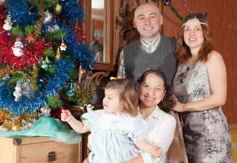 Happy couple with child visiting grandmother. For Christmas stock photo