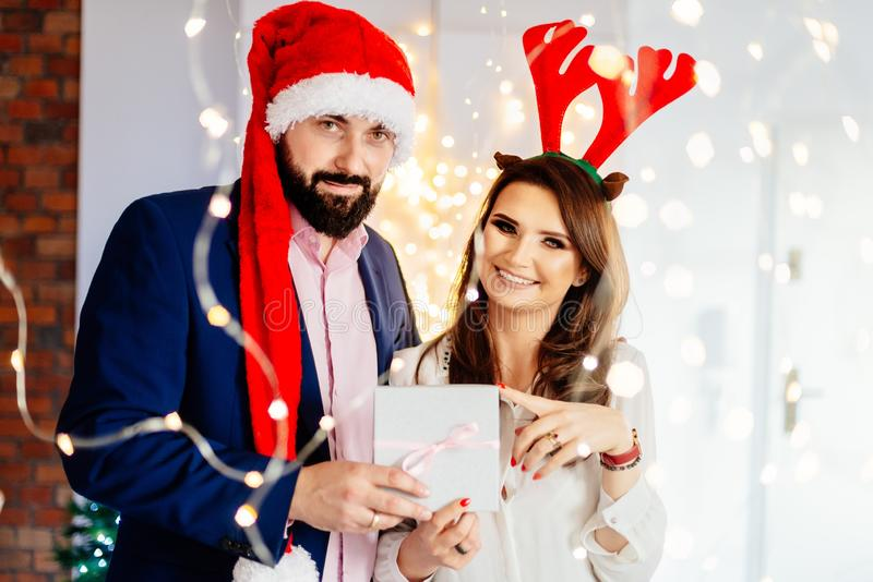Happy couple with Christmas gift. Man and women at christmas stock images