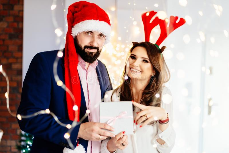 Happy couple with Christmas gift. Man and women at christmas royalty free stock images