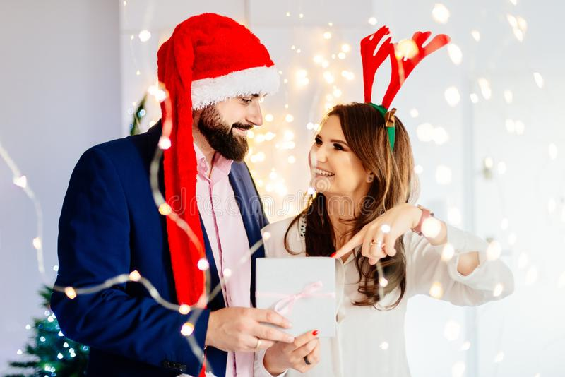 Happy couple with Christmas gift. Man and women at christmas stock photos