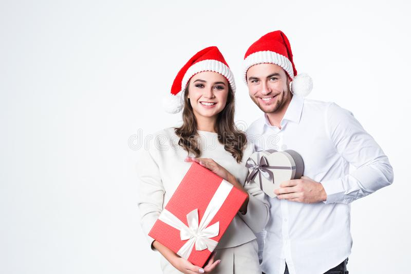 Happy couple with Christmas gifts. royalty free stock photo