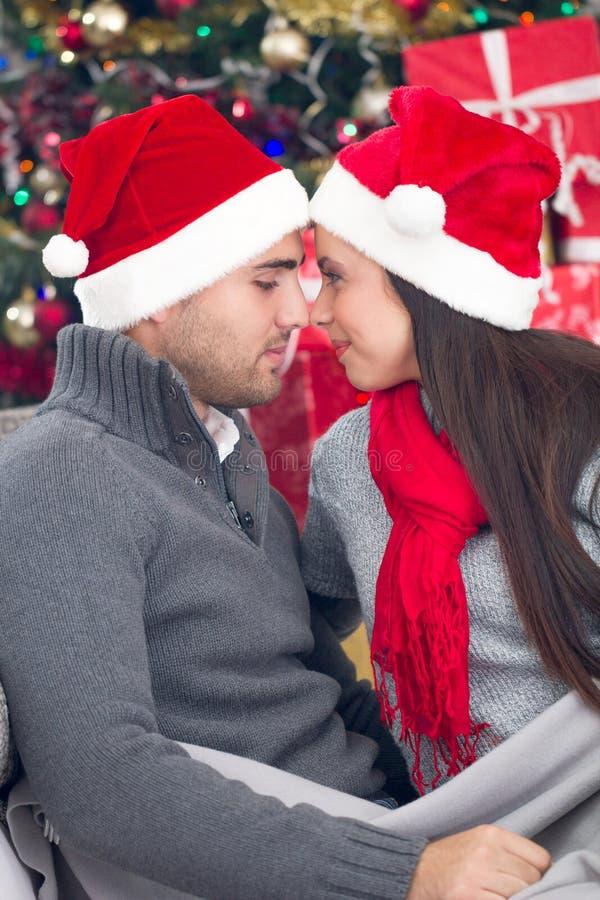 Happy couple at Christmas night stock image