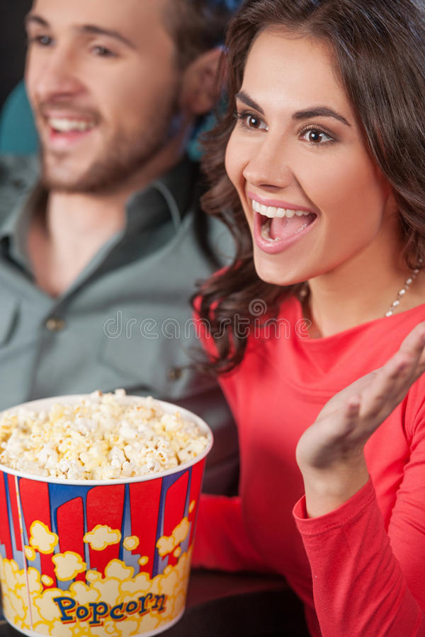 Happy couple at the cinema. stock image