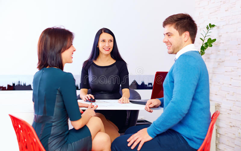 Happy couple at the consultant, in the office stock image