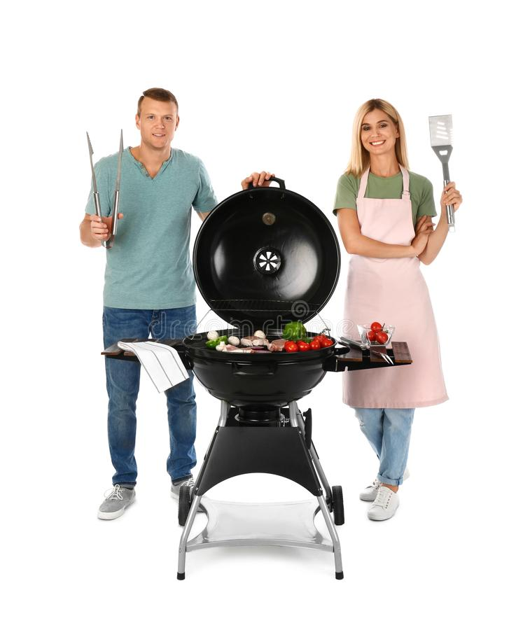Happy couple cooking on barbecue grill,  background royalty free stock photos