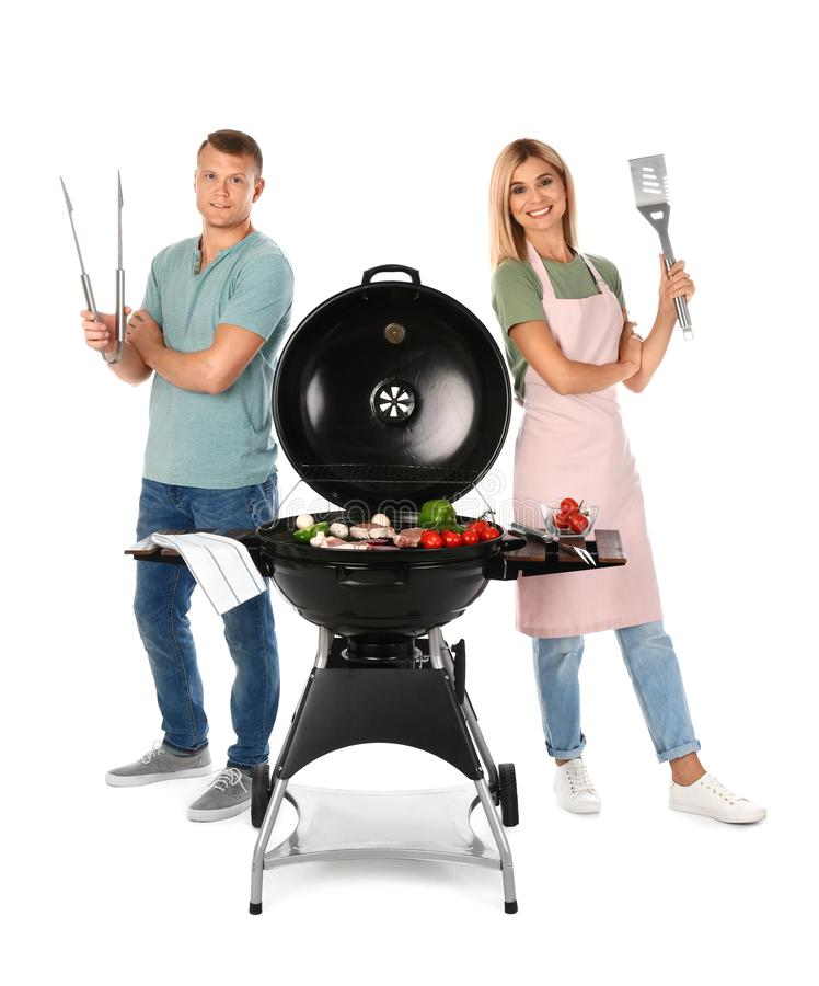Happy couple cooking on  grill, white background royalty free stock photo