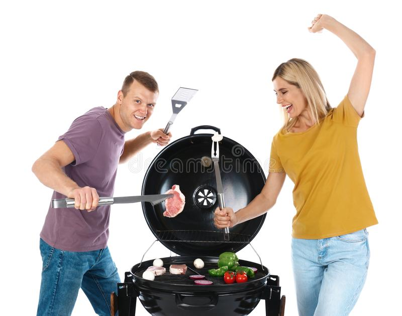 Happy couple cooking on  grill, white background. Happy couple cooking on barbecue grill, white background stock photos