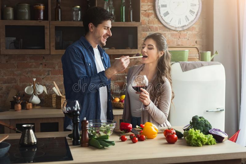 Happy couple cooking healthy food together royalty free stock photo