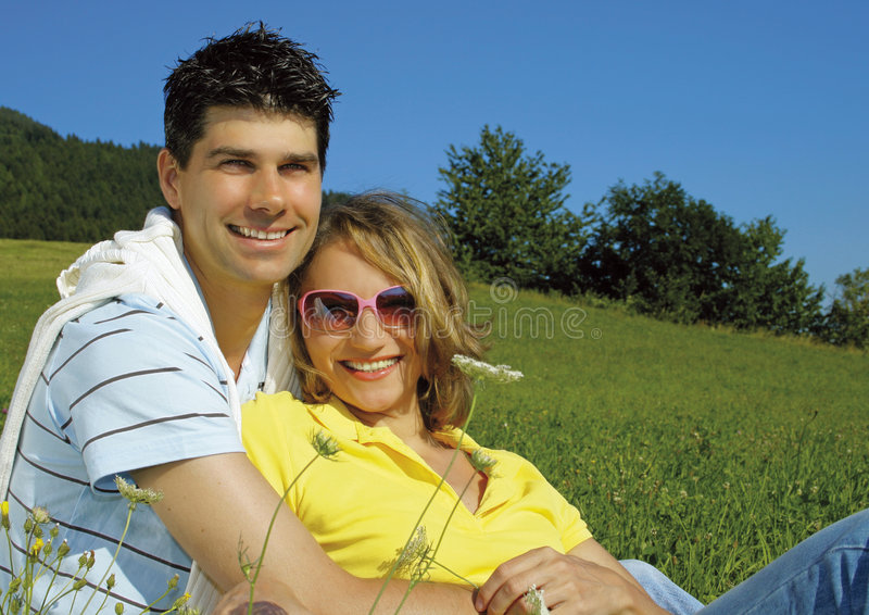 Happy couple in countryside stock images