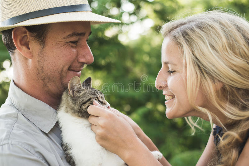 Happy couple with cute kitten stock photo