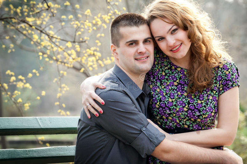 Happy couple - cute lovers in park. Happy couple - portrait of cute lovers in park stock images