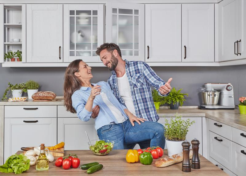 Couple dancing in the kitchen royalty free stock photo