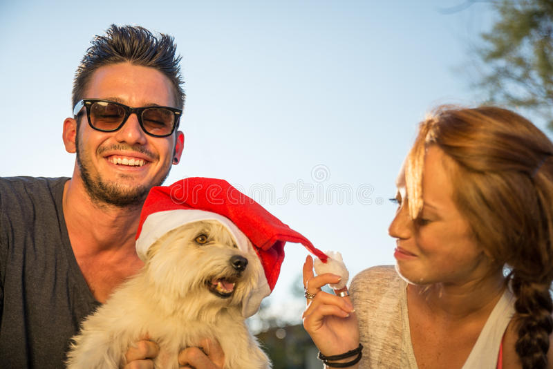 Happy couple with dog royalty free stock photos