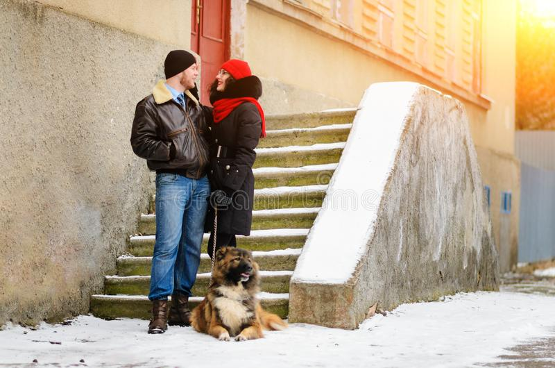 Happy couple with dogs in winter forest. Lovely moments outdoor royalty free stock photos