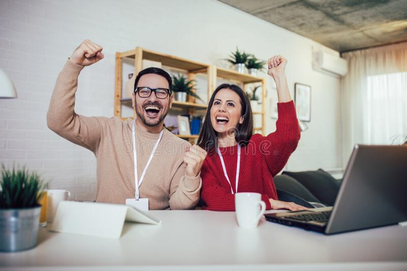 Couple doing business together working at home on the laptop. Happy couple doing business together working at home on the laptop royalty free stock photo