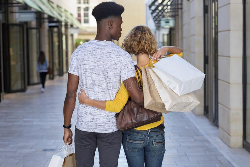 Happy couple doing shopping in town royalty free stock photography