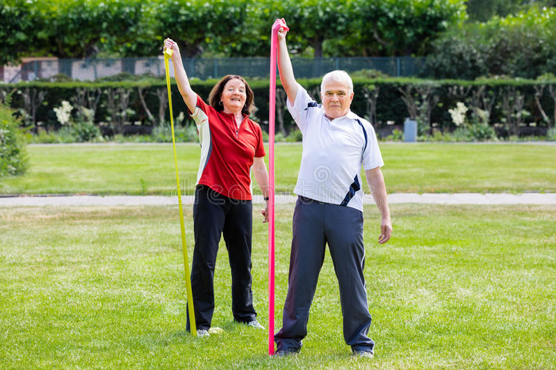 Happy Couple Doing Work Out stock image