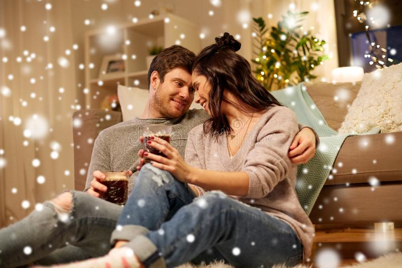 Happy couple drinking coffee and eating at home royalty free stock image