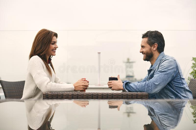 Happy couple is drinking tea in cafe royalty free stock photography