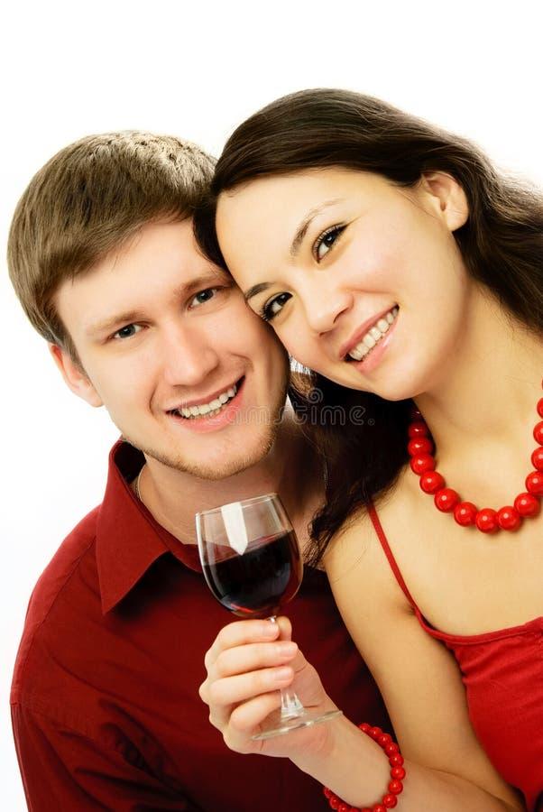 Happy couple drinking vine stock image