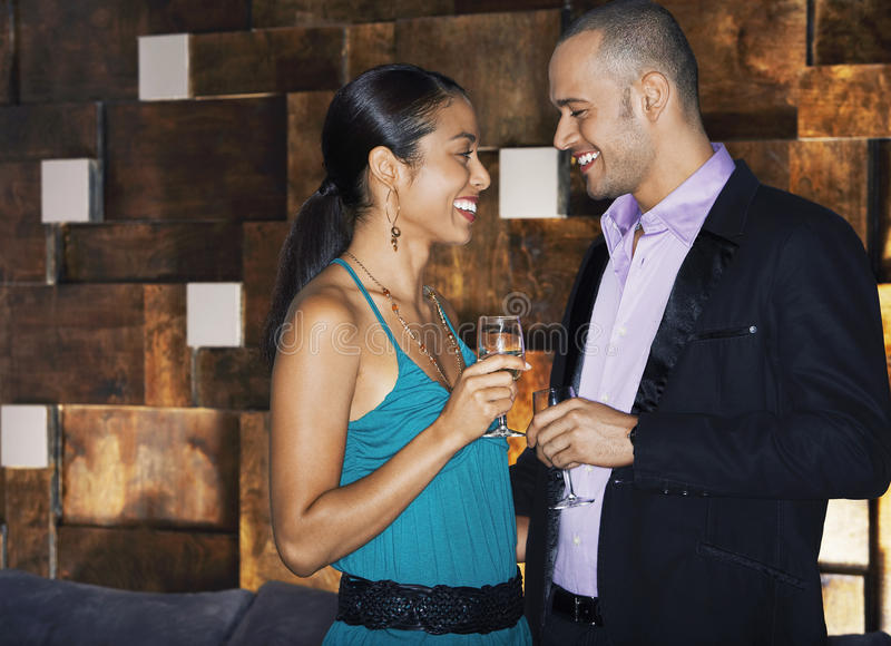 Happy Couple With Drinks In Bar