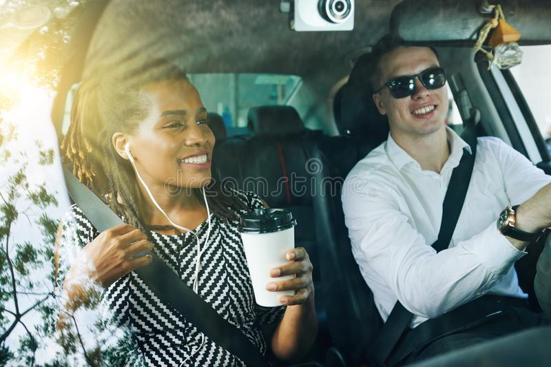 Happy couple driving together in the car royalty free stock photography