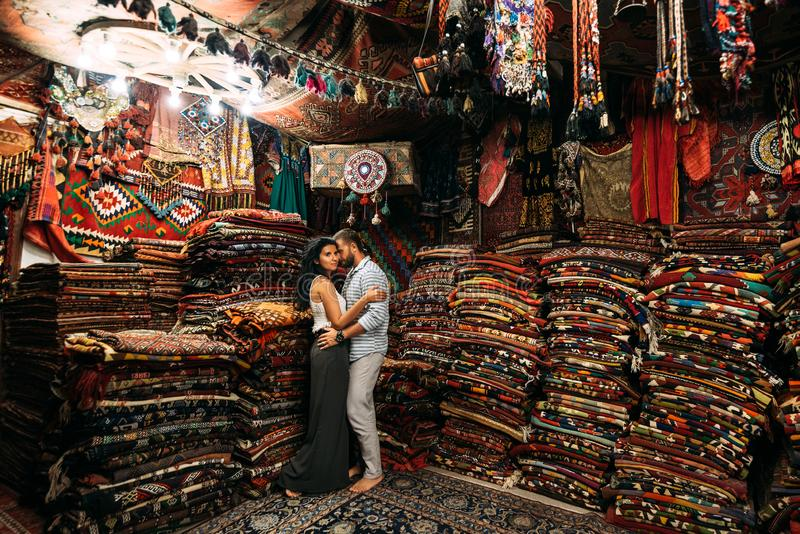 Happy couple in the Eastern country. Man and woman in the store. Couple in love in Turkey. Happy couple travels the world. Persian royalty free stock images