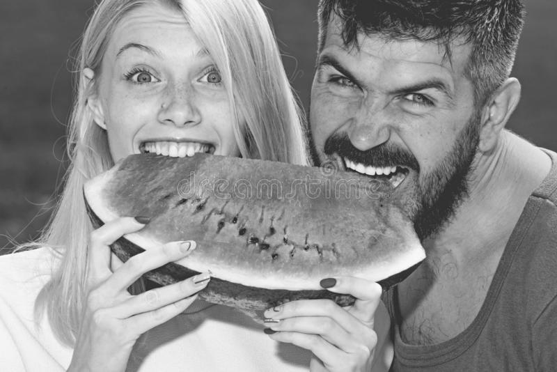 Happy couple eat watermelon. Vitamins and healthy concept. Enjoying a watermelon. Couple friends eating a watermelon stock image