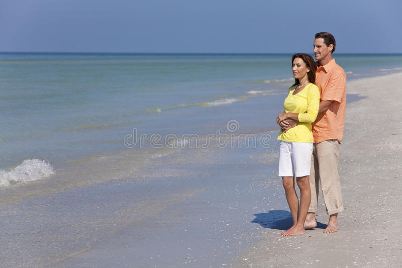 Download Happy Couple Embracing On An Empty Beach Stock Photo - Image: 23095260