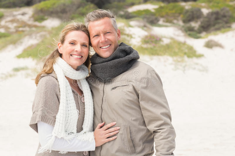 Happy couple embracing by the shore stock images
