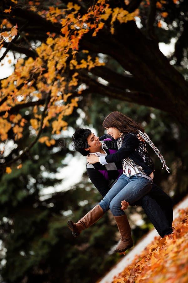 Happy Couple Enjoying Autum royalty free stock image