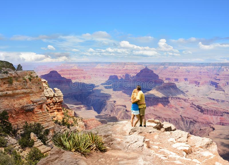 Happy couple enjoying beautiful mountain view on vacation. royalty free stock images