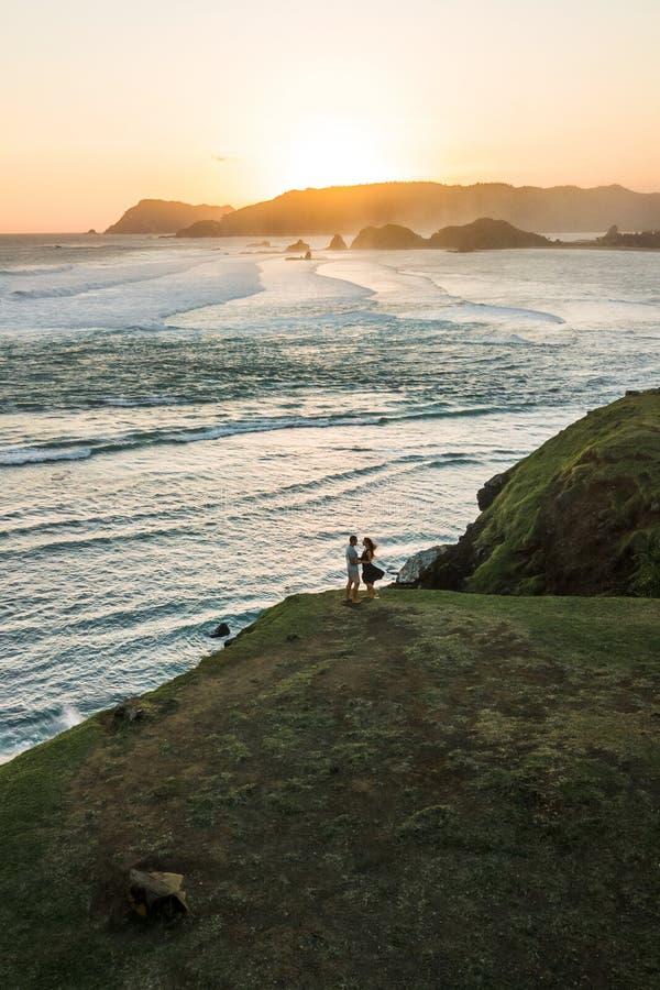 Happy couple enjoying sunset with amazing view royalty free stock photos