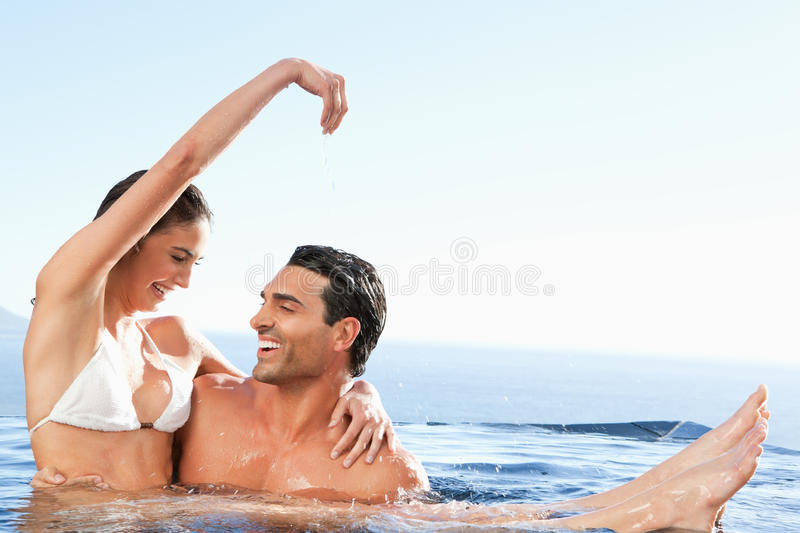 Happy Couple Enjoying Time Together In The Pool Stock Photography