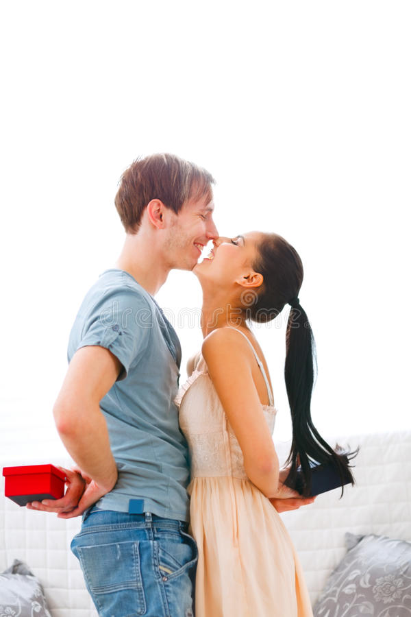 Happy couple exchanging gifts. Happy couple exchanging a gifts royalty free stock image
