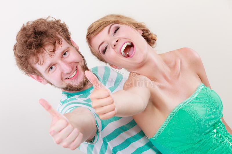 Happy couple excited smiling holding thumb up gesture, royalty free stock image