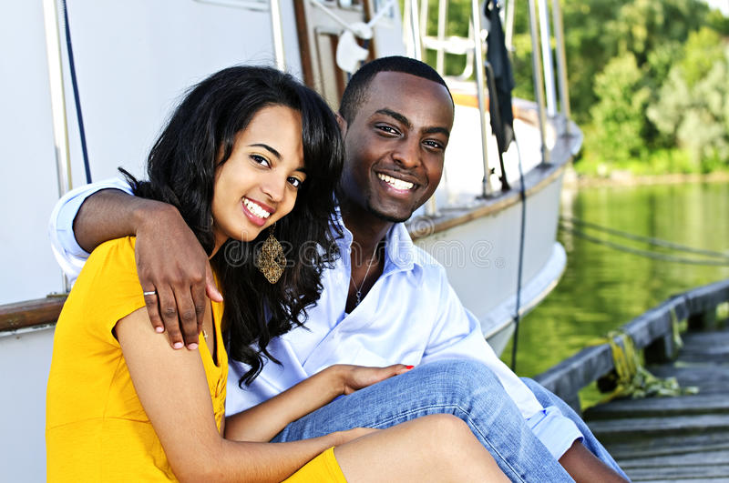 Happy couple in front of yacht royalty free stock image