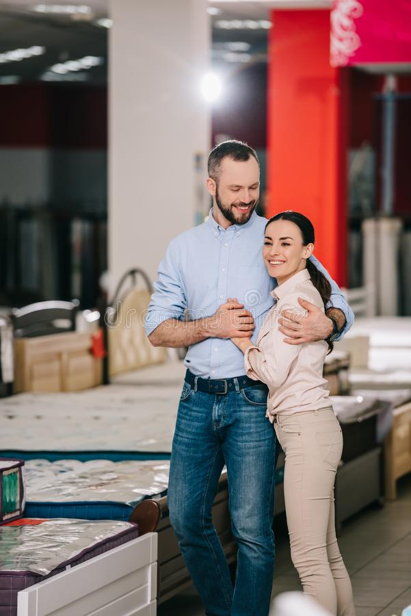 happy couple in furniture store stock photo