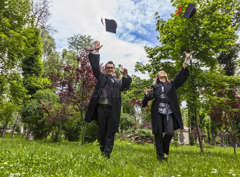 Download Happy Couple In The Graduation Day Stock Image - Image of mates, active: 39903099