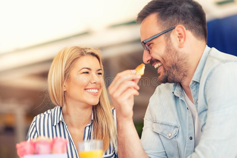 Happy couple have breakfast royalty free stock photography